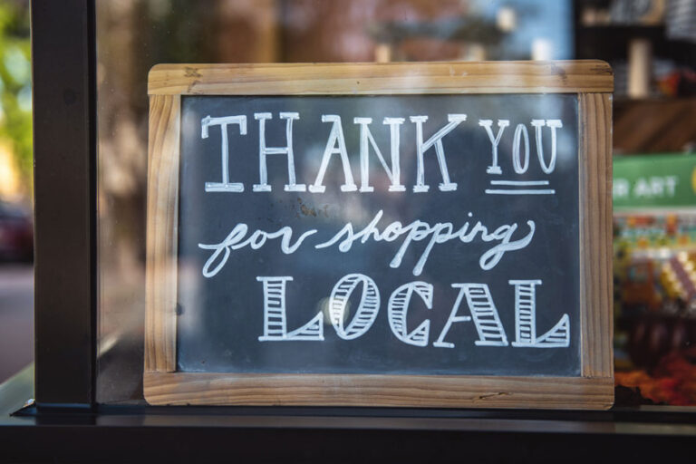 "An image saying ""thank you for shopping local,"" used to illustrate an article outlined strategies local leaders can take to support entrepreneurs in the recovery from COVID and the building of a more just and sustainable economy."
